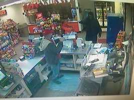 Surveillance image of a robbery at BFS/Marathon store on Route 51 in Rostraver Township.