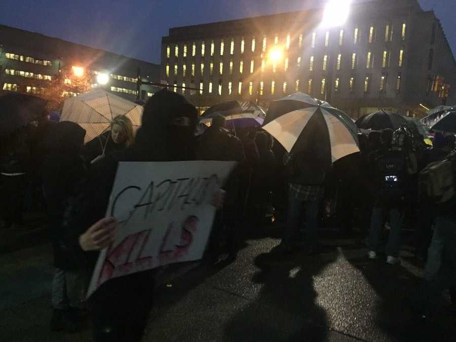 A large crowd formed at Schenley Plaza to protest the police-involved deaths of Mike Brown in Ferguson and Eric Garner in New York.