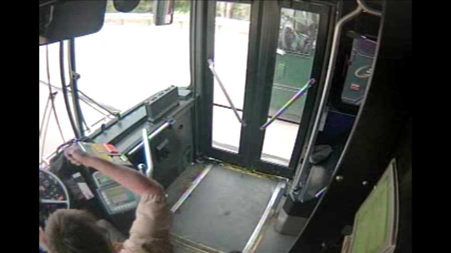 "A police officer describes this as a ""buggy-whip motion"" by bus driver Thomas Frauens toward fellow driver Juliann Maier."