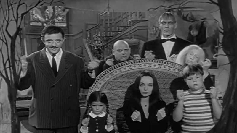 "Stars of ""The Addams Family"" TV show, clockwise from left: John Astin (Gomez), Jackie Coogan (Uncle Fester), Ted Cassidy (Lurch), Blossom Rock (Grandmama), Ken Weatherwax (Pugsley), Carolyn Jones (Morticia), Lisa Loring (Wednesday)."