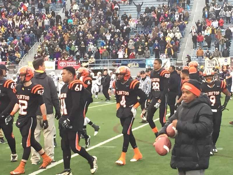 The Clairton High School football team walks off the field after a tough loss to Bishop Guilfoyle in the PIAA state championship game in Hershey.