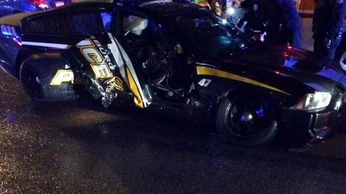 A Wilkinsburg police car was damaged in a crash that injured three people, including the police officer.