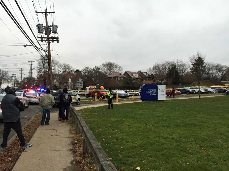 A body was found in a car parked outside Sunnyside Elementary School.