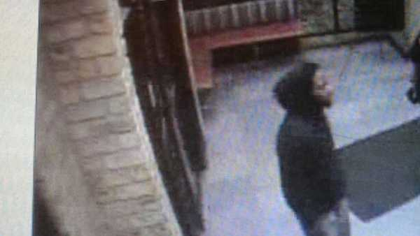 A surveillance video image of a suspect in a robbery outside South Hills Village.