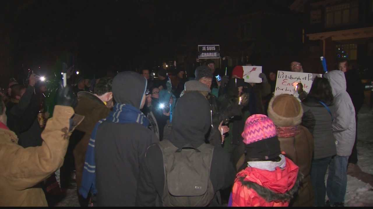 French Pittsburghers gathered Friday outside the home of the city's honorary consul of France, taking a stand against terror and honoring the victims of the Charlie Hebdo massacre in Paris.