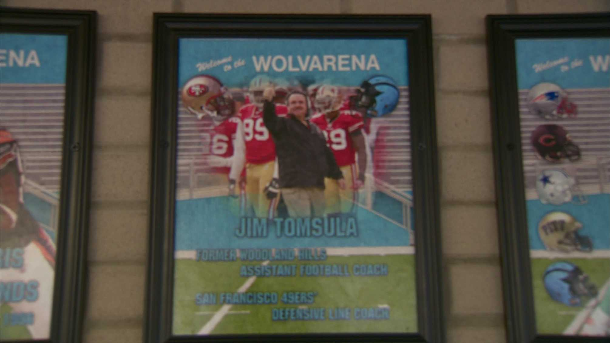 A picture of Jim Tomsula hangs on the Wall of Honor at Woodland Hills High School.