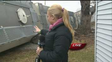 Pittsbrugh's Action News 4 reporter Ashlie Hardway shows how close the derailed train came to hitting a house in Uniontown.