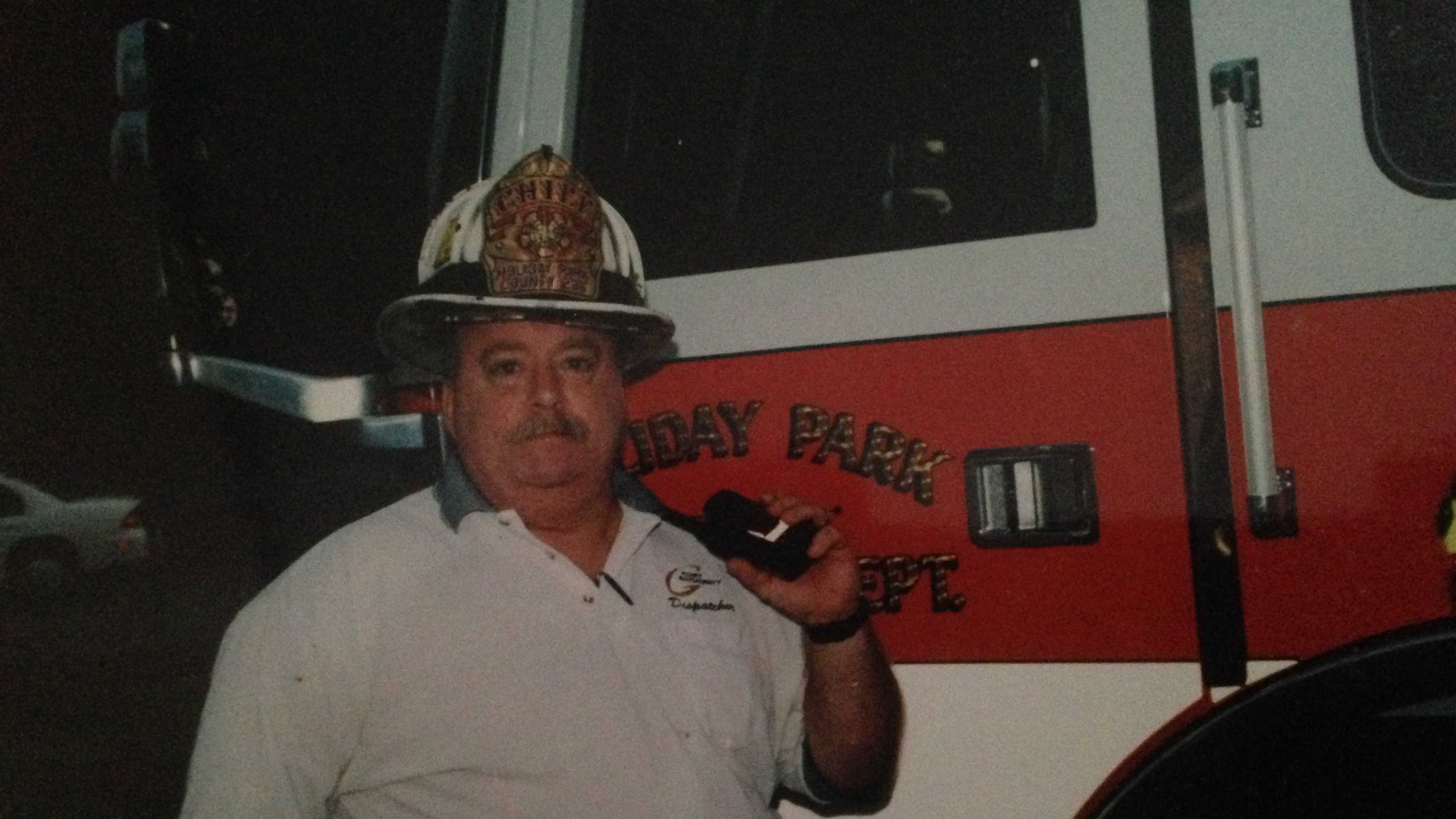 Chief Larry Glass in front of Engine 236-2 of the Holiday Park Volunteer Fire Department in Plum, PA