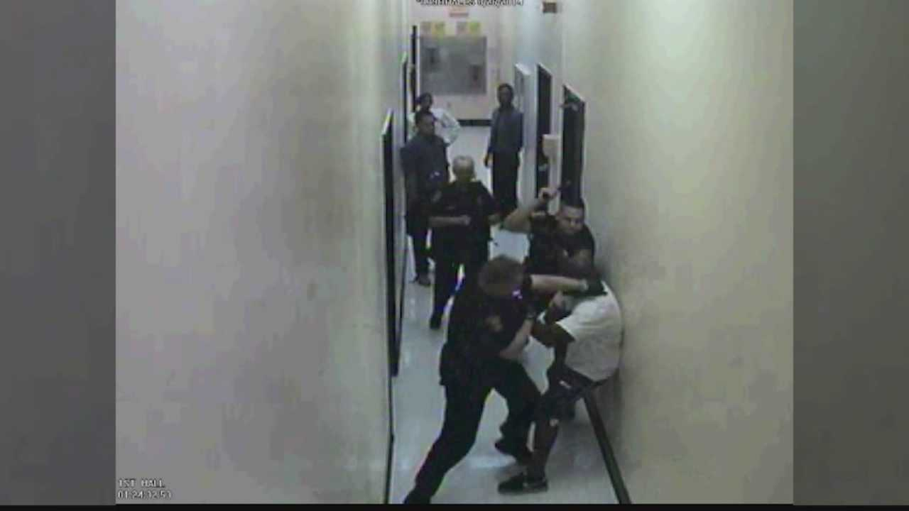 A video shows city police officers arresting an inmate at the Renewal Center.