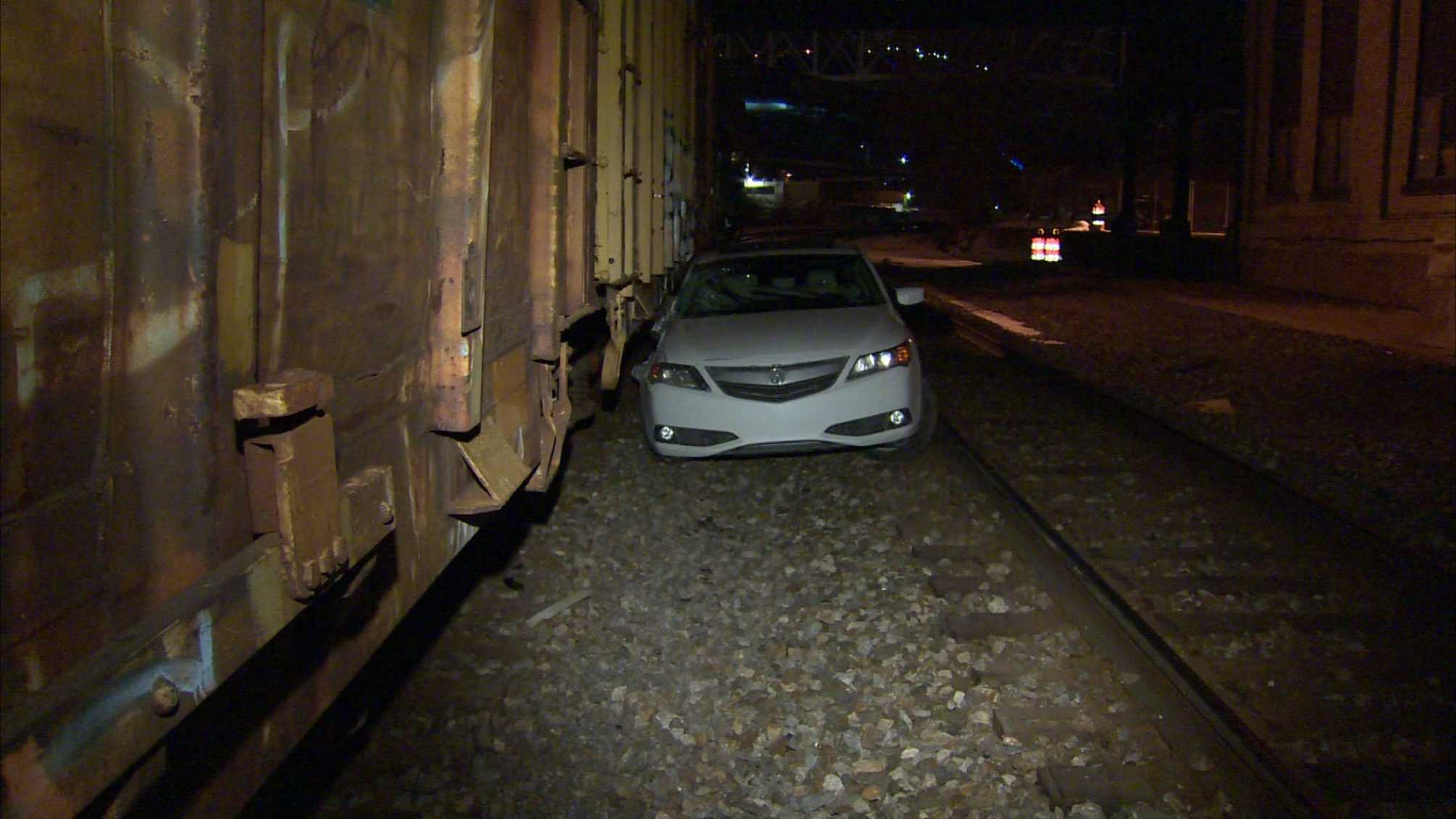 A parked car was hit by a train in the Southside just before 2 Saturday morning.