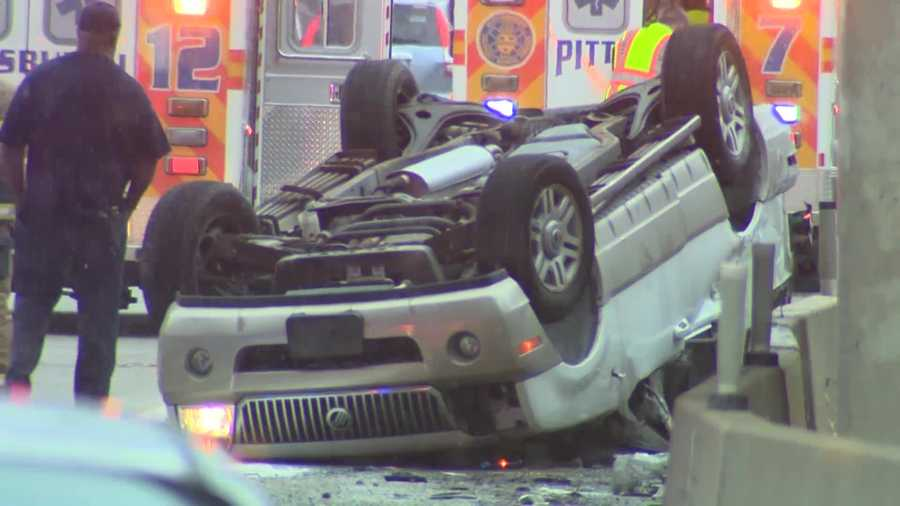 WATCH THE VIDEO: Car lands on roof on Parkway East
