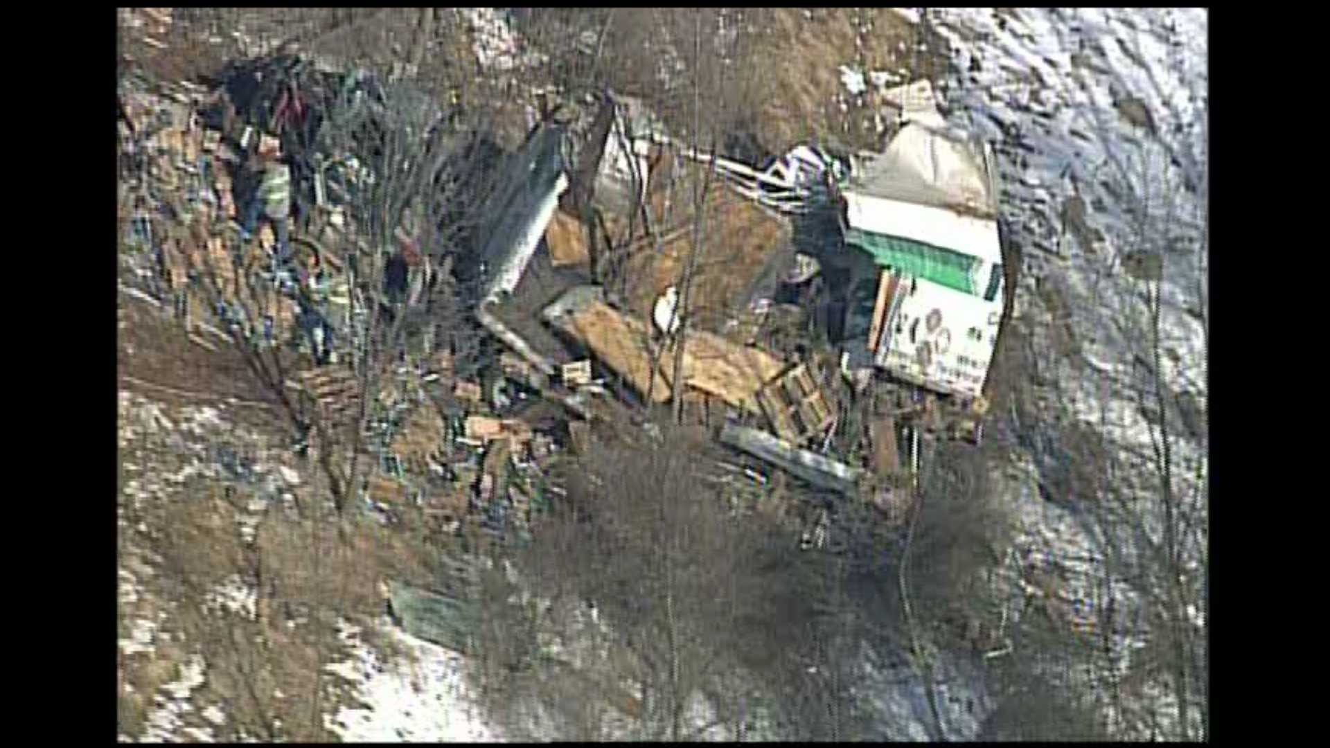 A tractor-trailer was ripped in half as it crashed on Interstate 70 and landed on a hillside off the highway.
