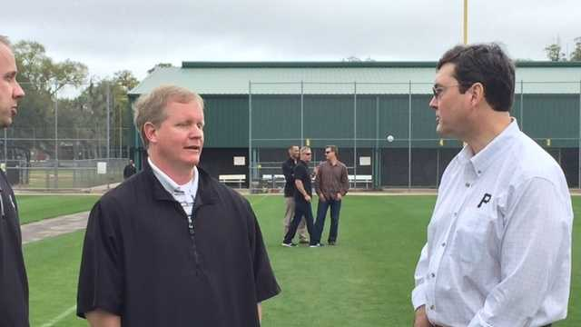 Pirates owner Bob Nutting (right) talks with general manager Neal Huntington at spring training.