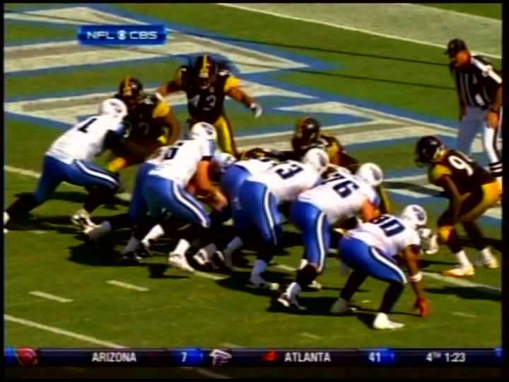 Troy Polamalu jumps over Tennessee's offensive line and sacks Kerry Collins.