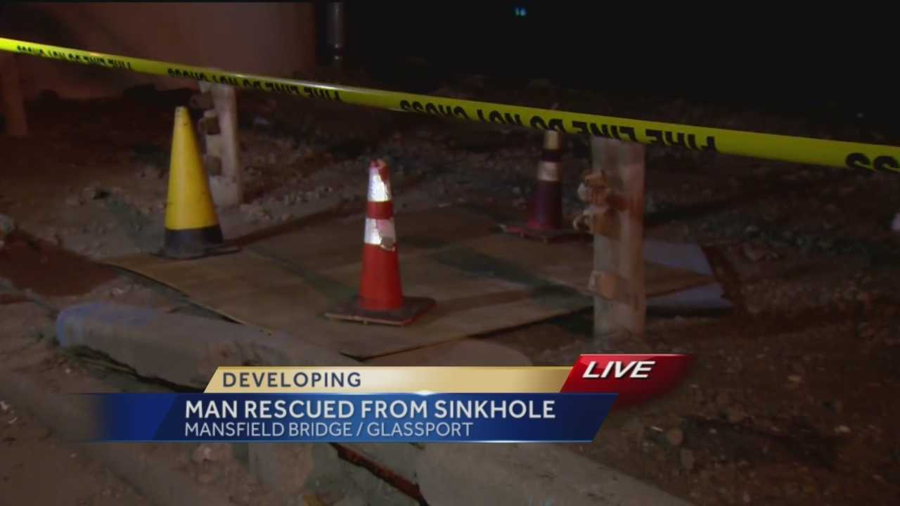 Pittsburgh's Action News reporter Courtney Fischer reports from the sinkhole where a man was trapped for over an hour Friday night under the Mansfield Bridge.