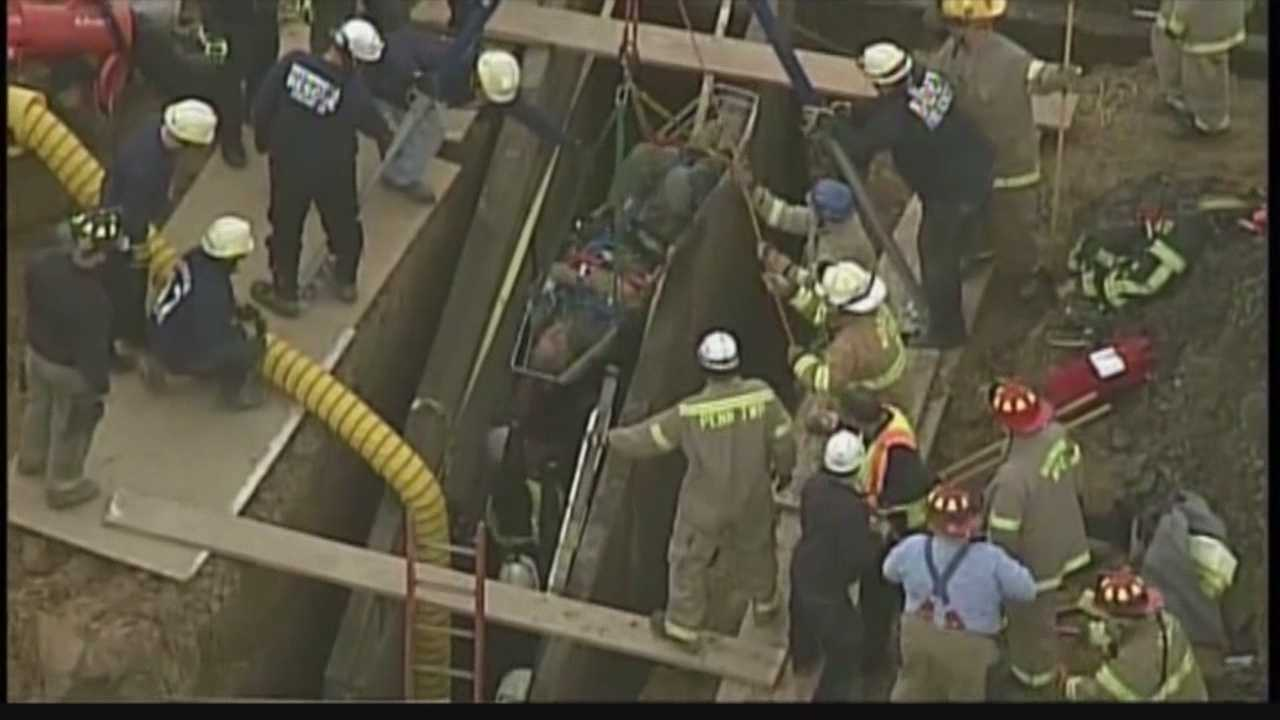 Rescue crews converged on a housing construction site in Forward Township to save a man who became trapped in a trench Tuesday morning.