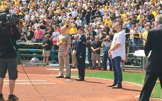 Chris Jamison (standing right, wearing Pirates jersey) was invited to sing the national anthem at the home opener.