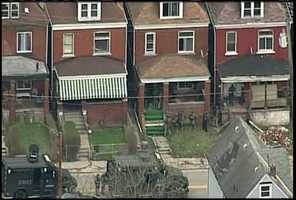 The SWAT team was called after gunshots were fired near a Pittsburgh police car on Blackadore Avenue in Homewood.