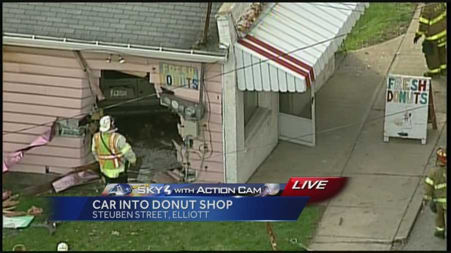 A car drove through the side of the building on Steuben Street, leaving a huge hole, and crashed into an area where customers stand.