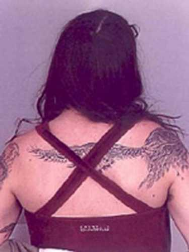 Tattoo of bird on back