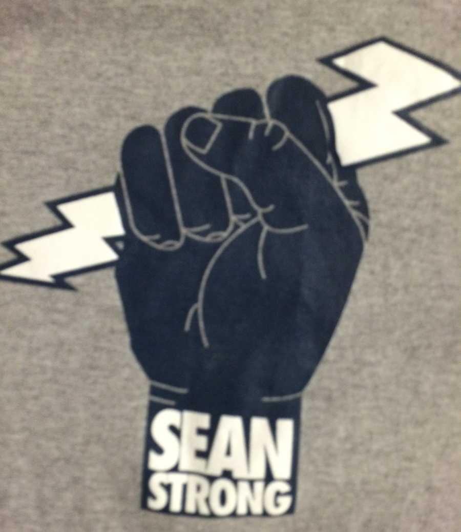 "SEAN STRONG: Sean shows me his ""SeanStrong"" shirt"