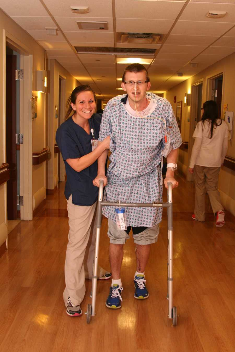 WALKING DOWN MEMORY LANE: More coincidence! Physical Therapist Erin Boyle walks with Sean. Erin is a former classmate of Sean's at St Mary's School in Glenshaw. Erin asked Sean to his first school dance at St Mary's!