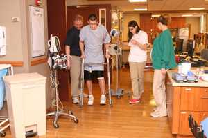 STEP BY STEP: Sean's team at UPMC Mercy, literally re-teaching Sean how to walk again. Sean suffered burns to more than 35% of his body.