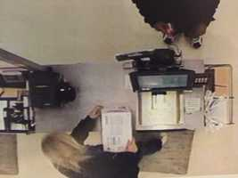 Police say this surveillance image shows Jordan Clemons using Karissa Kunco's father's debit card to buy an Xbox.