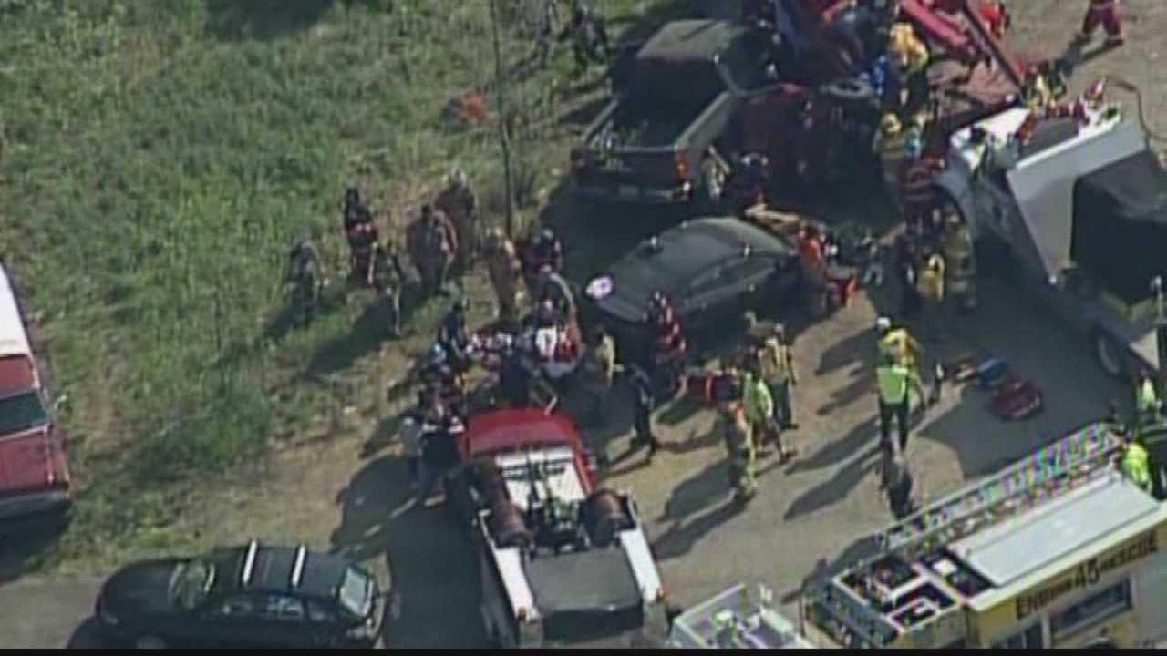 Sky 4 over the scene of a runaway tow truck crash as one victim is rescued from a car involved in the accident.