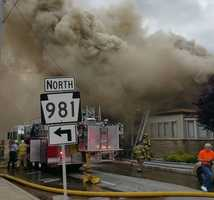 Firefighters from a dozen fire departments battled an morning fire on the 500 block of Main Street in Latrobe on Wednesday.
