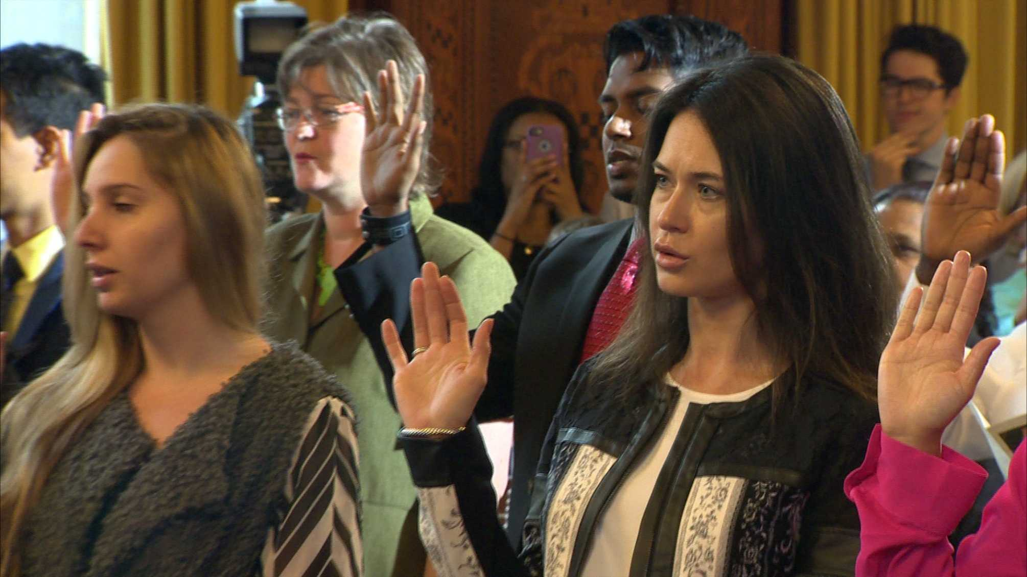 More than two dozen new U.S. citizens pledge their allegiance to their new country at the first-ever naturalization ceremony in Pittsburgh City Council Chambers.