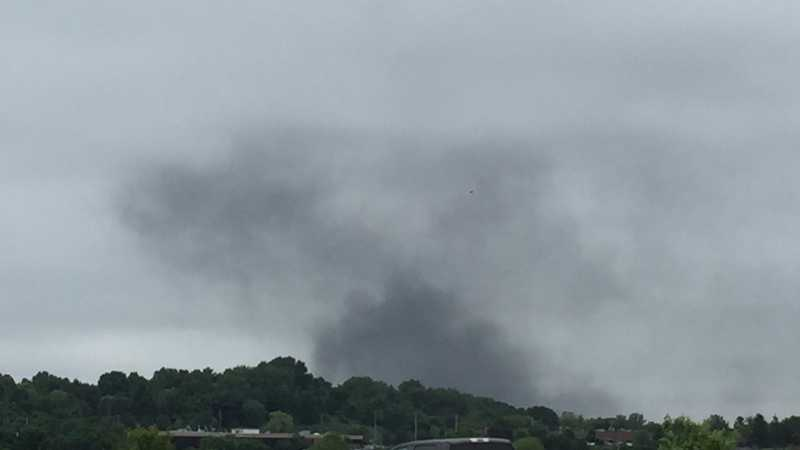 Smoke rises from a fire at a plant in Harmar Township.