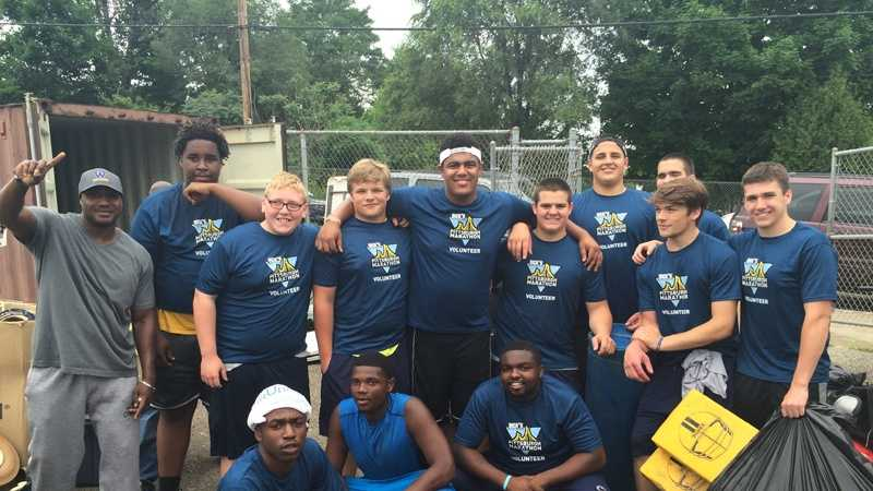 Football players from Westinghouse and Central Catholic high schools teamed up for a community service project to help clean up Willie Stargell Field in Homewood.