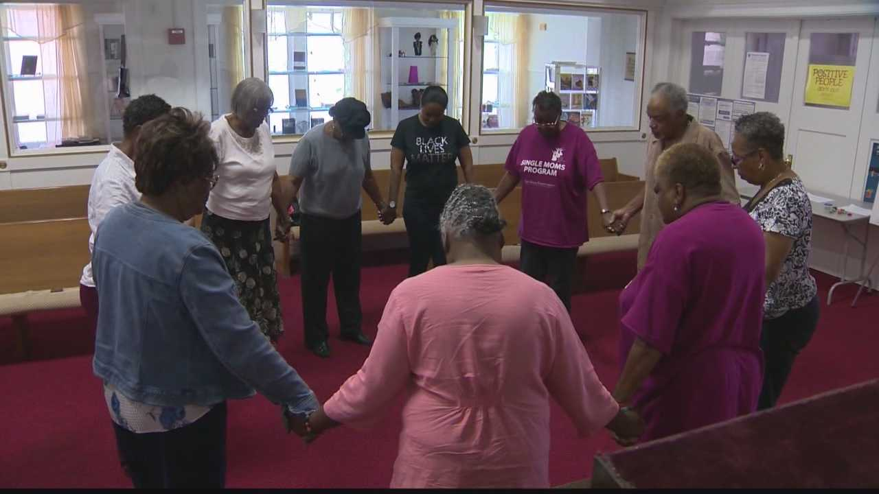 Following the mass shooting in Charleston, SC., local African Methodist Episcopal Church members, some of them friends of the victims, react with prayer vigils.