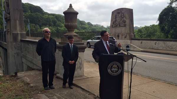 "Mayor Bill Peduto announces the ""Greenfield Bridge Rock Away the Blues Party,"" accompanied by headlining act Joe Grushecky and City Councilman Corey O'Connor."