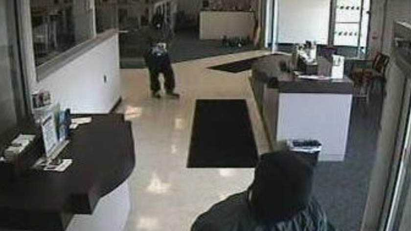 Three masked men are accused of robbing a Bethel Park bank at gunpoint. Police said the First Niagara Bank in the Hillcrest Shopping Center on Liberty Road was robbed at about 9:30 a.m. Friday.
