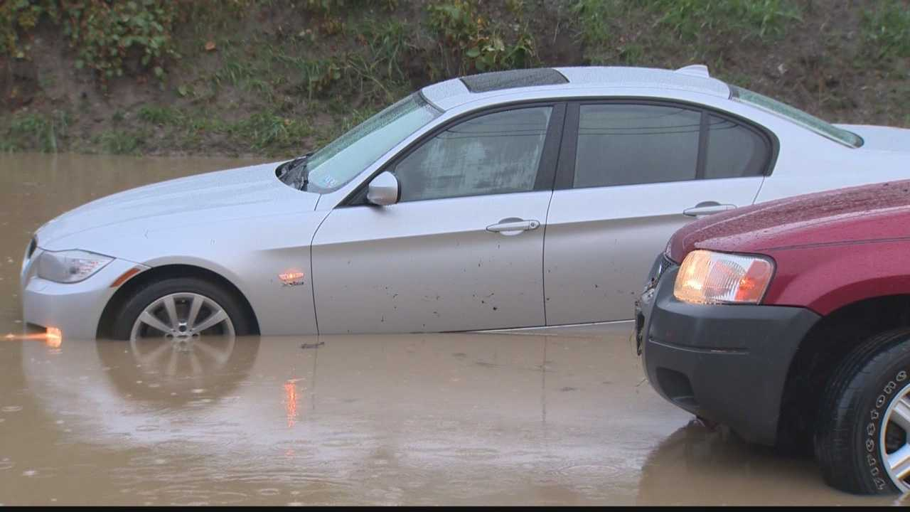 Five people had to be rescued when cars they were in got stuck in waist-deep water on a busy road in Pittsburgh's South Hills suburbs.