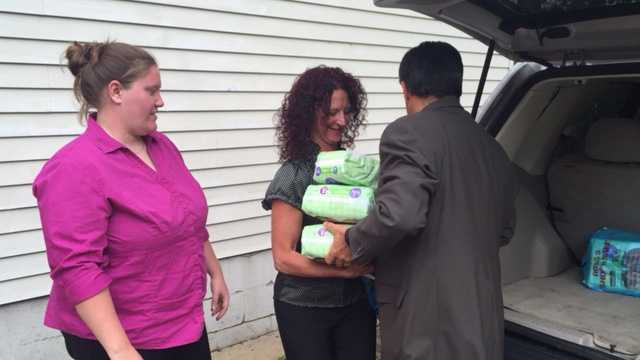A donation of diapers is made to the Center for Victims.