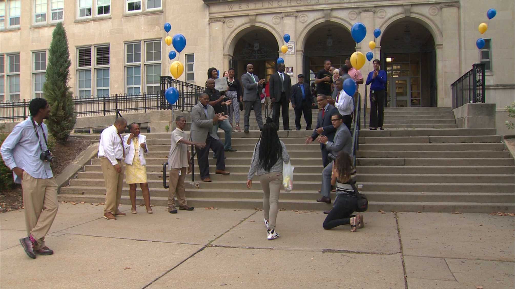 Westinghouse High School students are welcomed as they arrive for the first day of school.