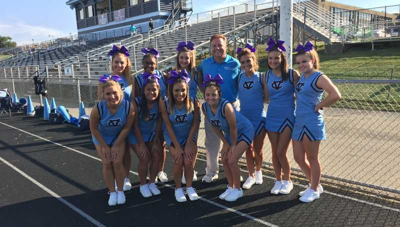 Pittsburgh's Action Sports anchor Guy Junker with the Central Valley High School cheerleaders.