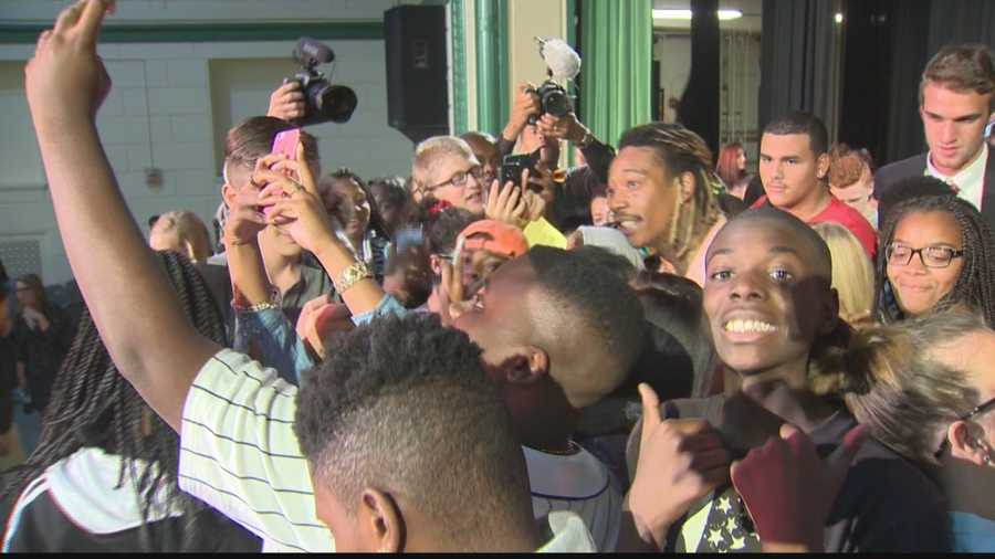 Allderdice students take selfies with Wiz Khalifa.