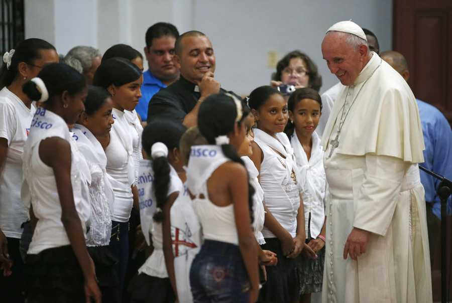 Pope Francis talks with a group of children in the sanctuary of the Virgin of Charity of Cobre, in El Cobre, Cuba.