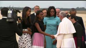 Sasha Obama greets Pope Francis.