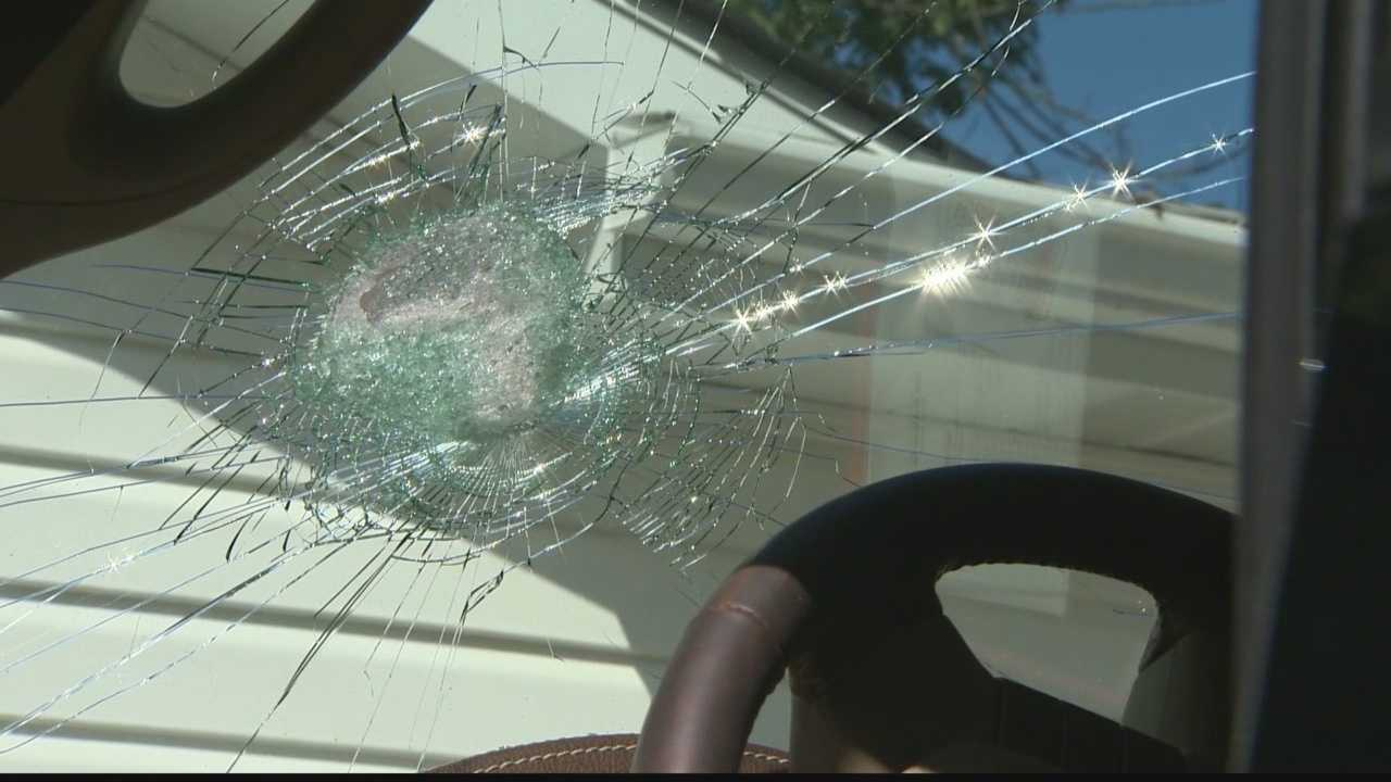 State police say three young men tossed rocks at passing cars along I-70 hitting several cars and damaging at least six.