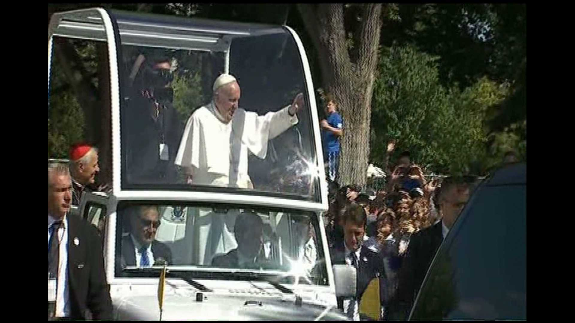 The pope rode in a Jeep and took part in a parade. Washington Archbishop Donald Wuerl, the former bishop of Pittsburgh, was seated next to him.