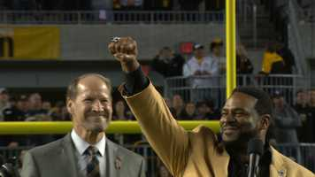 Jerome Bettis, wearing his gold jacket, receives his Hall of Fame ring at halftime of the Steelers-Ravens game, in front of the fans and city he loves so much.