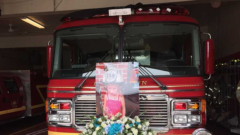 A photo of Ava Campbell is displayed on a fire truck in Shaler Township.