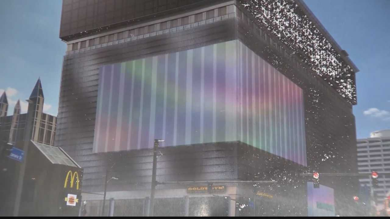 A proposal to install a 40-by-75 foot LED display wrapping around the corner of several floors of the former Kossman Building in downtown Pittsburgh has been rejected by the city planning commission.