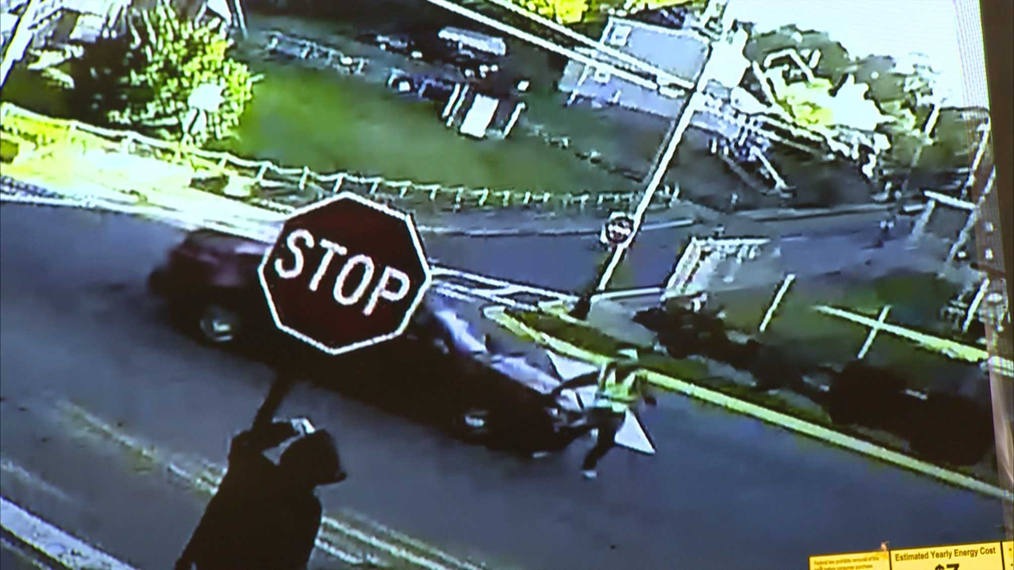 This surveillance video image shows a vehicle hitting a crossing guard.