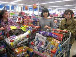 Blayke Bridge, Celeste Kaneshiro and MaKenna Griggs shopping for toys to give to children experiencing homelessness during the holidays.